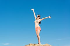 Beautiful woman spread her arms Stock Images