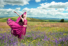 Beautiful woman in the spring blooming field Stock Photo