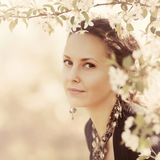 Beautiful woman in a spring blooming garden Royalty Free Stock Photos