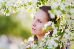 Beautiful woman among a spring blossom Stock Photo