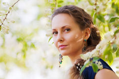 Beautiful woman among a spring blossom Royalty Free Stock Images