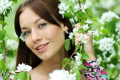 Beautiful woman in spring blossom Stock Photography