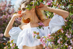Beautiful woman in spring blossom trees. Royalty Free Stock Photos