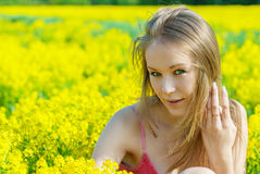 Beautiful woman on spring field Royalty Free Stock Images
