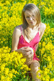 Beautiful woman on spring field Royalty Free Stock Photos