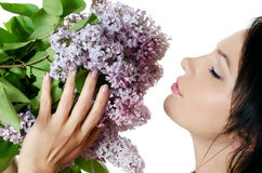 Beautiful woman with spring flowers of a lilac Stock Photography
