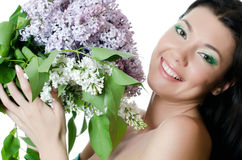Beautiful woman with spring flowers of a lilac. Skincare Stock Images