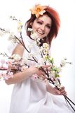 Beautiful woman with spring flowers smiles Royalty Free Stock Image
