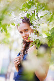 Beautiful woman in a spring garden Stock Photo
