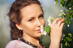 Beautiful woman in a spring garden Stock Photography