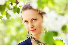 Beautiful fashion woman in a spring garden Stock Image