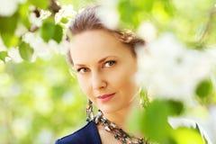 Beautiful fashion woman in a spring garden Stock Image