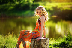 Beautiful woman in spring garden Stock Images