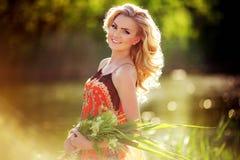 Beautiful woman in spring garden Stock Photos