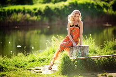 Beautiful woman in spring garden Stock Photography