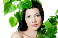 Beautiful woman with spring green leaves Royalty Free Stock Images