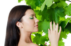 Beautiful woman with spring green leaves Stock Photo
