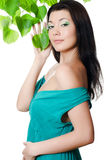 Beautiful woman with spring green leaves Stock Image