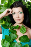 Beautiful woman with spring green leaves Royalty Free Stock Photography