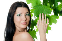 Beautiful woman with spring green leaves Stock Photography