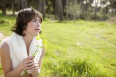 Beautiful woman in a spring landscape Stock Photos