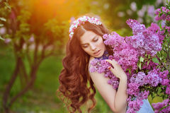 Beautiful woman in the Spring Park and the setting sun royalty free stock photos