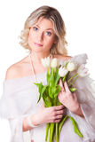 Beautiful woman with spring tulips on white Royalty Free Stock Photo