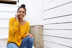 Beautiful woman on staircase making phone call Royalty Free Stock Photo