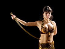 Beautiful woman stand with sword royalty free stock images