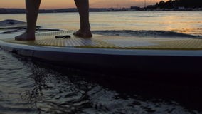Beautiful woman on Stand Up Paddle Board. SUP. stock video footage