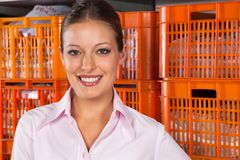 Beautiful Woman Standing Against Baskets Stock Image