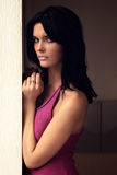 Beautiful woman standing against a wall stock image