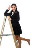 Beautiful woman standing on alluminium ladder Royalty Free Stock Image