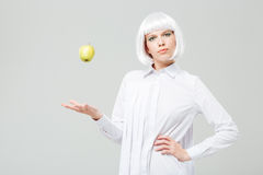 Free Beautiful Woman Standing And Throwing Apple In The Air Royalty Free Stock Photography - 73413297