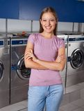 Beautiful Woman Standing Arms Crossed In Laundry Stock Images