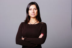 beautiful woman standing with arms folded Stock Photo