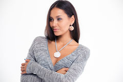 Beautiful woman standing with arms folded Royalty Free Stock Photos