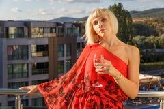 Beautiful woman standing on balcony Royalty Free Stock Photo