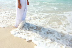 Beautiful woman standing at the beach Stock Photo