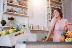 Beautiful woman standing behind the counter of her juice bar. Portrait of beautiful young woman standing behind the counter of her juice bar. Caucasian female Stock Photography
