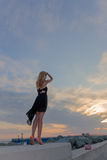 Beautiful woman standing blue sky sunset Royalty Free Stock Photography