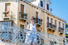 Beautiful woman standing on bridge in Venice, Italy Royalty Free Stock Photography