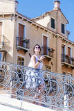 Beautiful woman standing on bridge in Venice, Italy Royalty Free Stock Photo