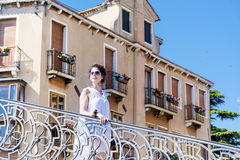 Beautiful woman standing on bridge in Venice, Italy Stock Image