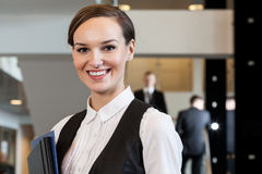 Beautiful woman standing in business centre Royalty Free Stock Photo