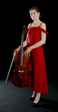 Beautiful woman standing with a cello Royalty Free Stock Photos