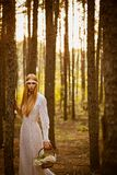 Beautiful woman standing in forest Stock Photos