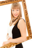 Beautiful woman standing with frame and smiling Royalty Free Stock Photography