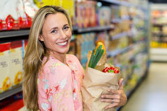 Beautiful woman standing with grocery bag Royalty Free Stock Images