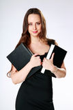Beautiful woman standing and holding books Royalty Free Stock Images